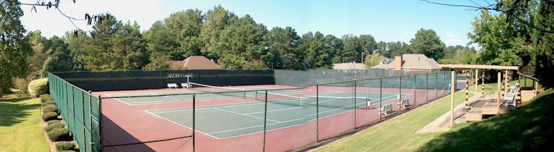 Two Hard-Surface Tennis Courts In Community