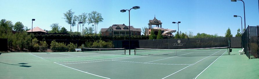 Tennis Courts And Water-Slide Tower In Background