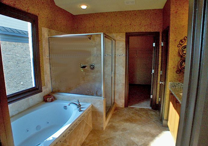 Jetted Garden Tub, Separate Shower, Artisan Tiles, Dual Italian Vanities And Granite Counters.